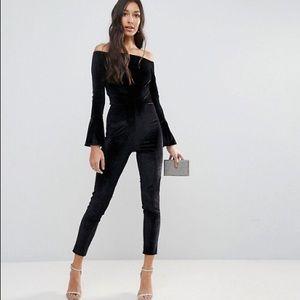 Black velvet off-shoulder flute sleeve jumpsuit